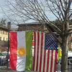 kurdish and american flags at the turkish embassy